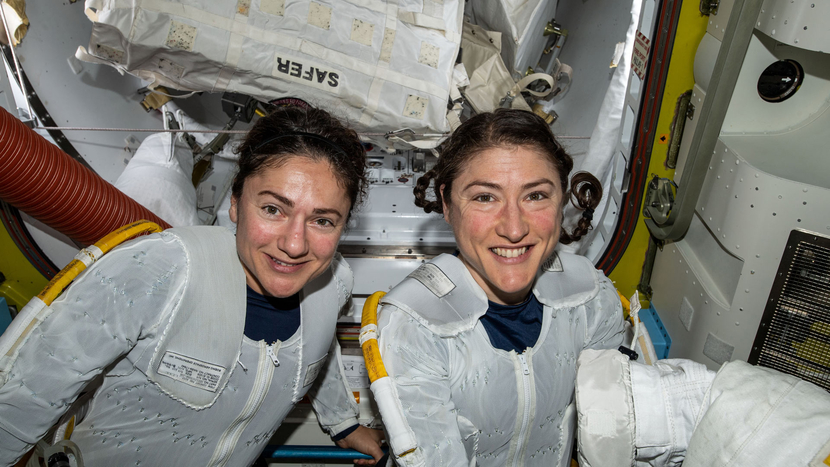NASA astronauts Jessica Meir (left) and Christina Koch (right) put on their spacesuits as they prepare to leave the hatch of the International Space Station and begin the historical first-ever all-female spacewalk.
